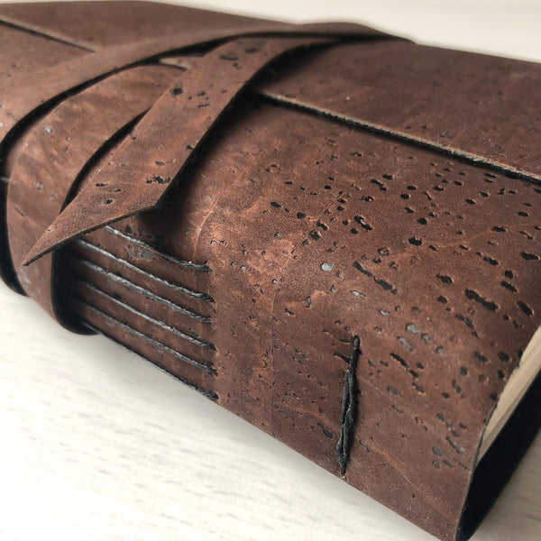 Brown faux leather, cork leather notebook close up