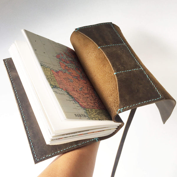 A5 brown leather travelers notebook with stitched card slots, back open view