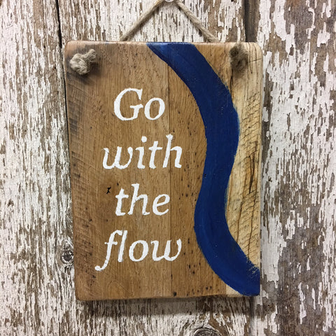 go with the flow reclaimed wood sign handpainted in white with a blue swish