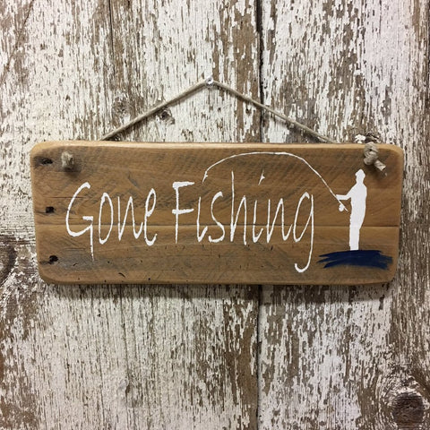 Gone Fishing Reclaimed Wood Sign handpainted with gone fishing and fisherman in white wading in blue water