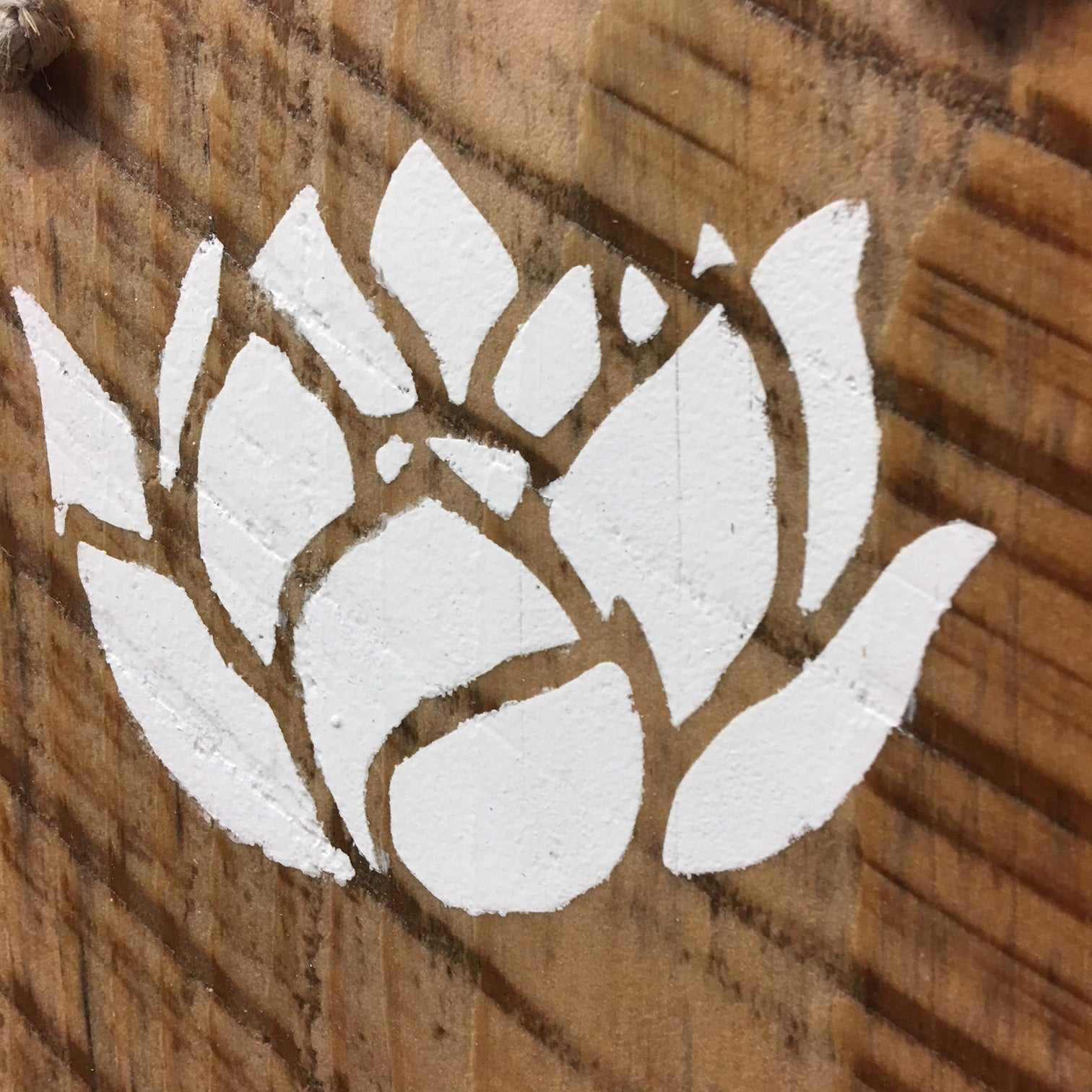 white lotus flower reclaimed wood sign rebirth enlightenment