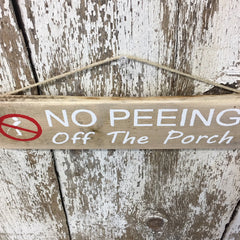 wood signs with funny saying no peeing off the porch decor