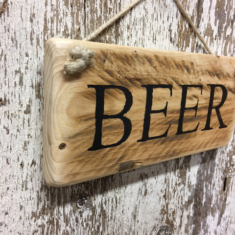 wooden beer sign on reclaimed wood for beer lover