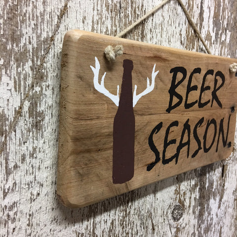 deer and beer sign together beer season with deer antlers on bottle