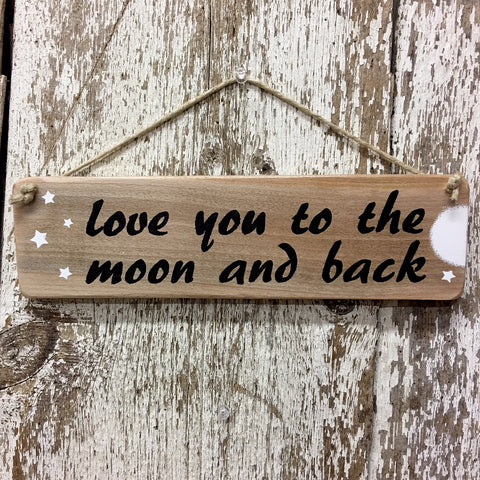 love you to the moon and back hand painted sign in black script with white moon and stars on reclaimed upcycled wood