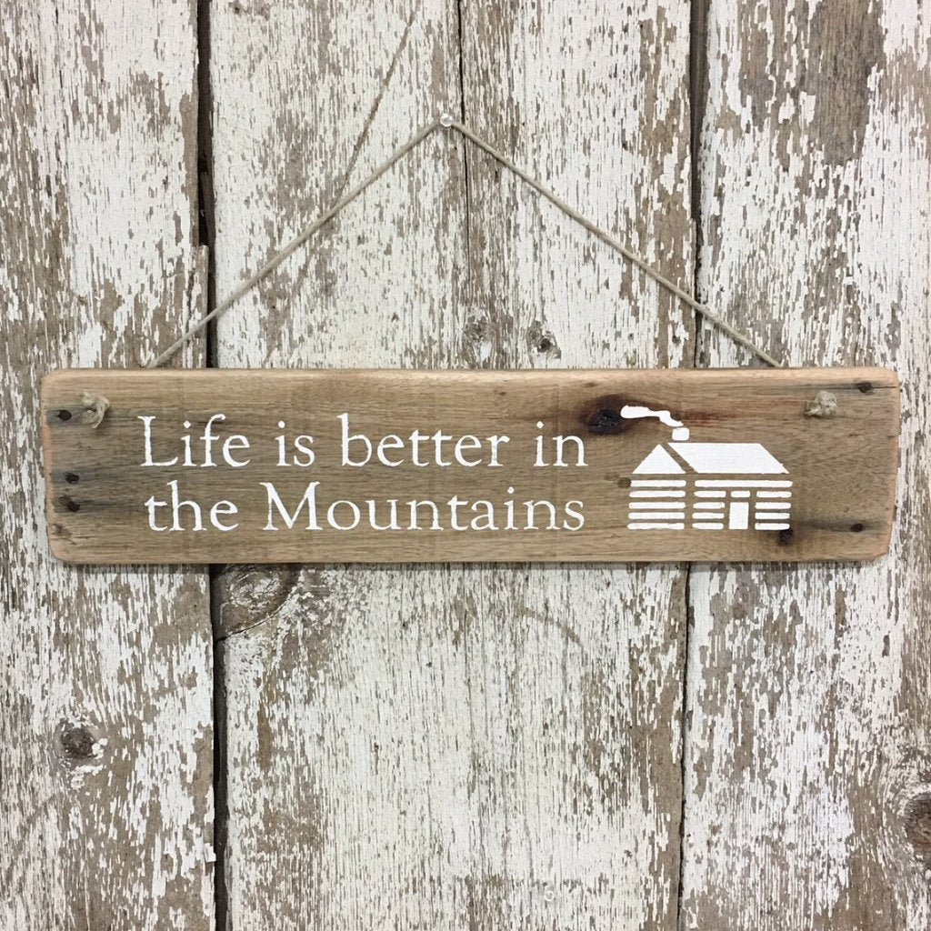 Life is better in the mountains wood sign with cabin painted in white