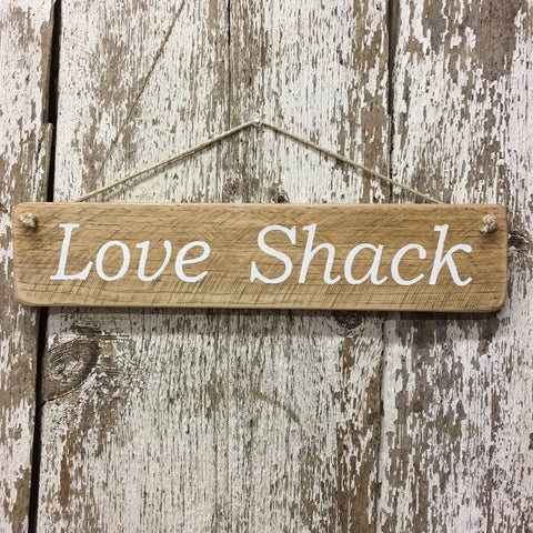 love shack sign on reclaimed wood hand painted in white