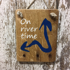river life sign on river time arrow reclaimed wood sign