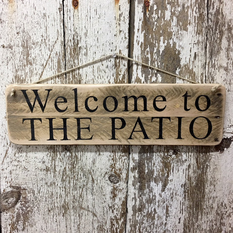 welcome to the patio wood sign painted in black welcome signs