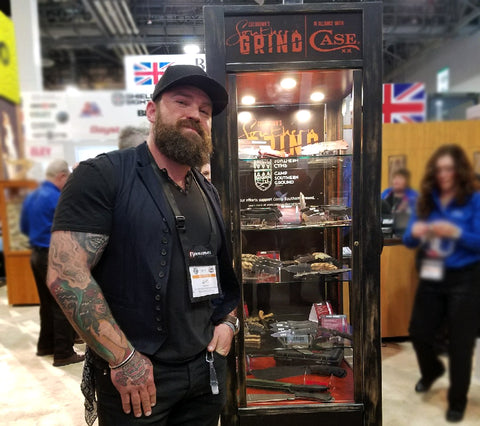 Zac Brown Stands Next To Display Of Southern Grind Knives