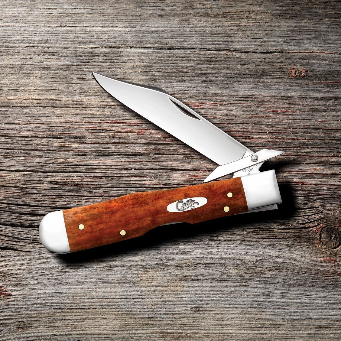 Front view of the Chestnut Bone Smooth Cheetah® open showing the clip blade on a wooden background
