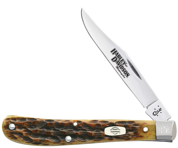Harley-Davidson® Jigged Antique Bone Slimline Trapper open showing the front of the knife