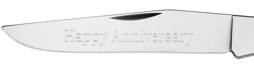Example of custom engraving on a blade in Bookman font