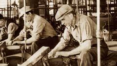 Historical photo of Case employees in factory