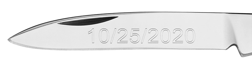Example of custom engraving on a blade in Arial font