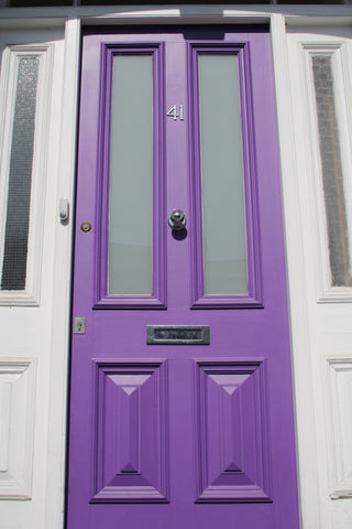 Ome Smart Doorbell on Purple Door