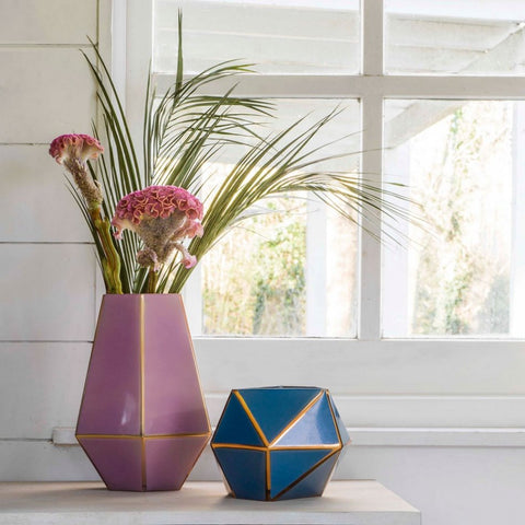 Ome Smart Doorbell loves glass and metal vases in pink and blue