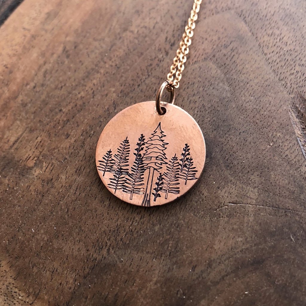 hand stamped copper forest pendant