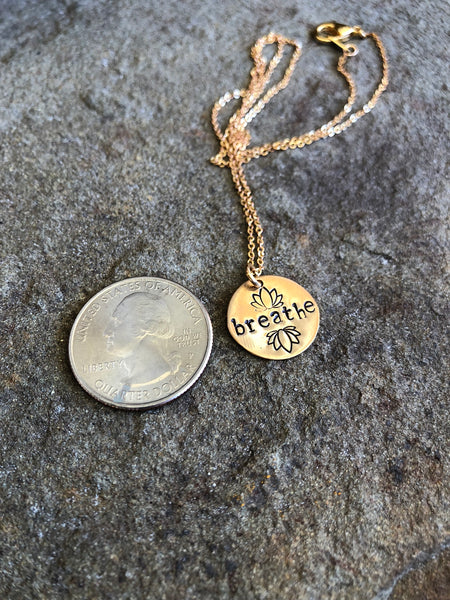 "hand-stamped brass ""breathe"" necklace"