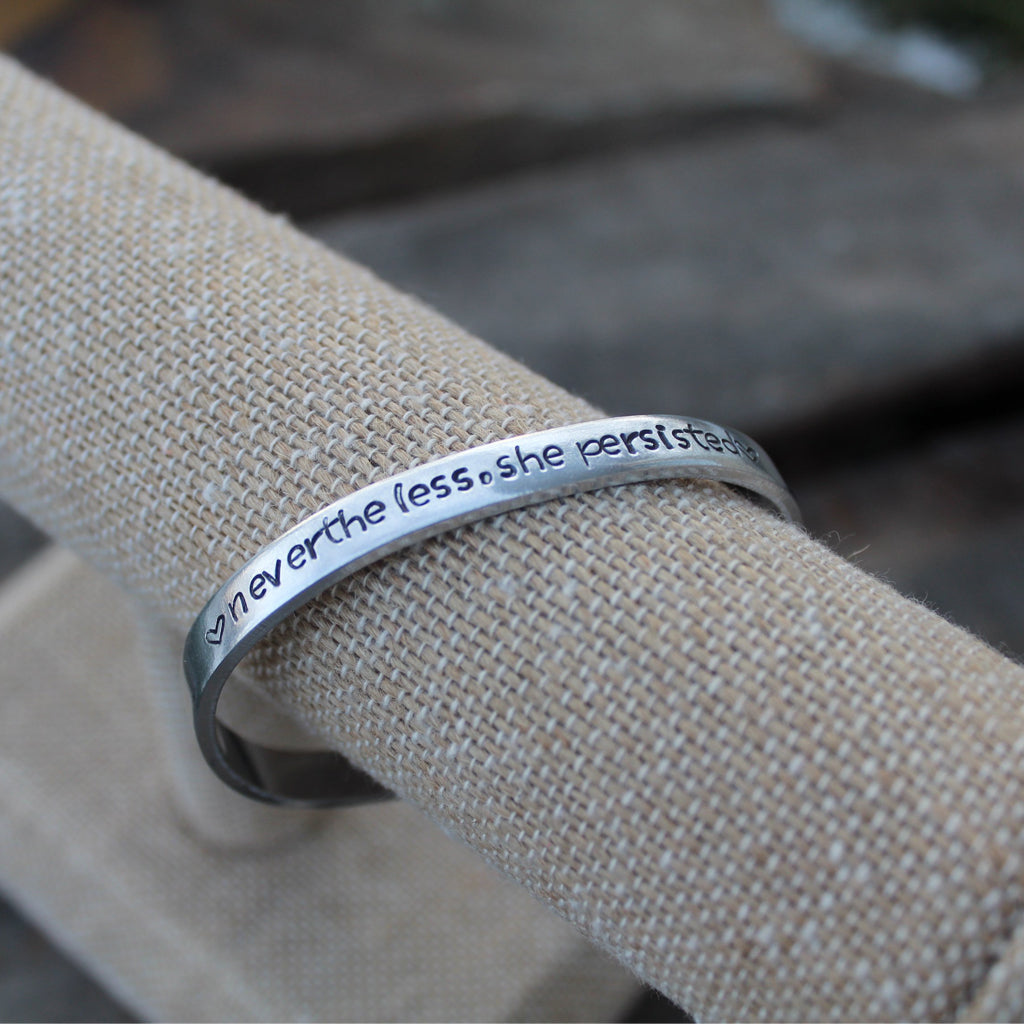 """nevertheless, she persisted"" hand-stamped cuff bracelet"