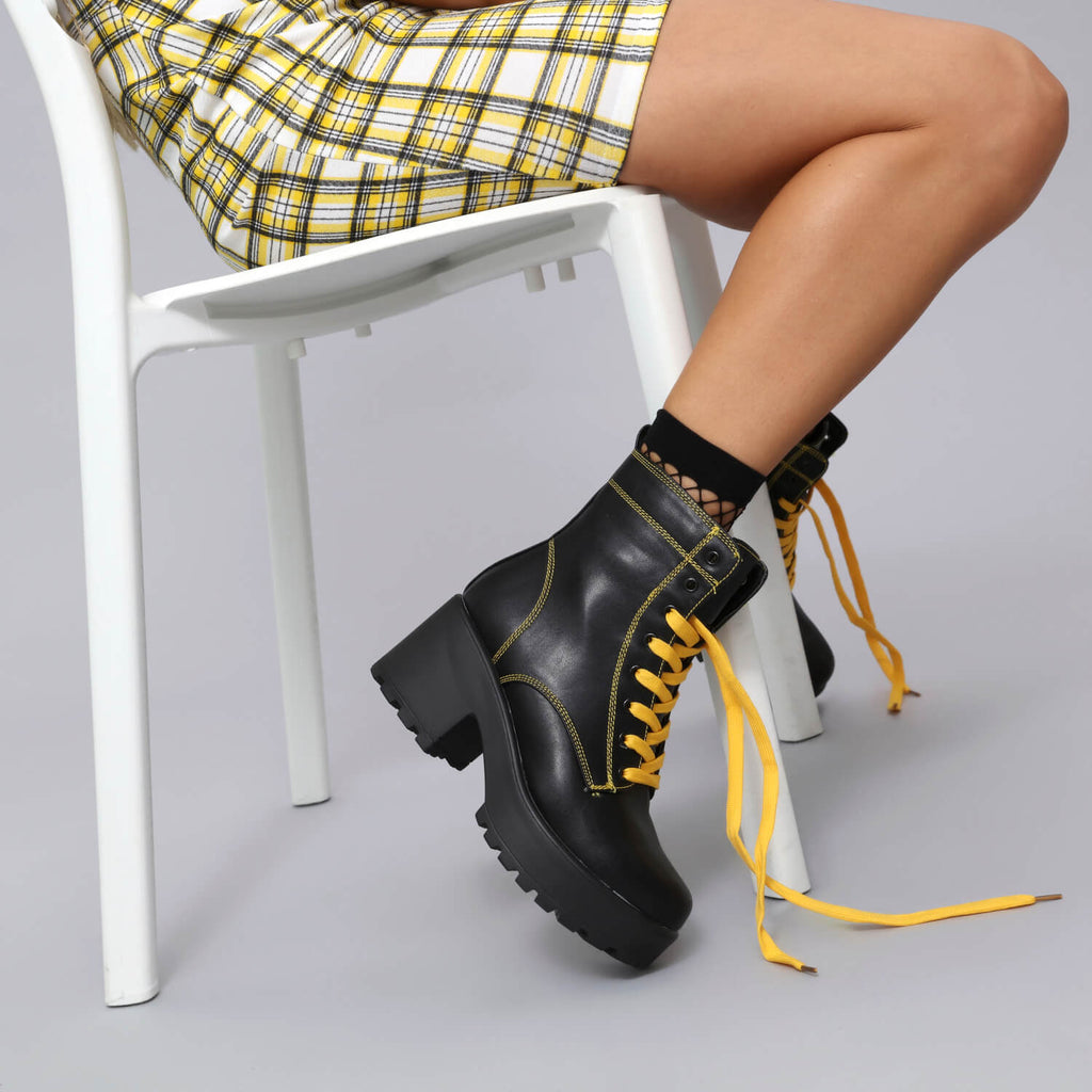 Kitana yellow laced boots size 10