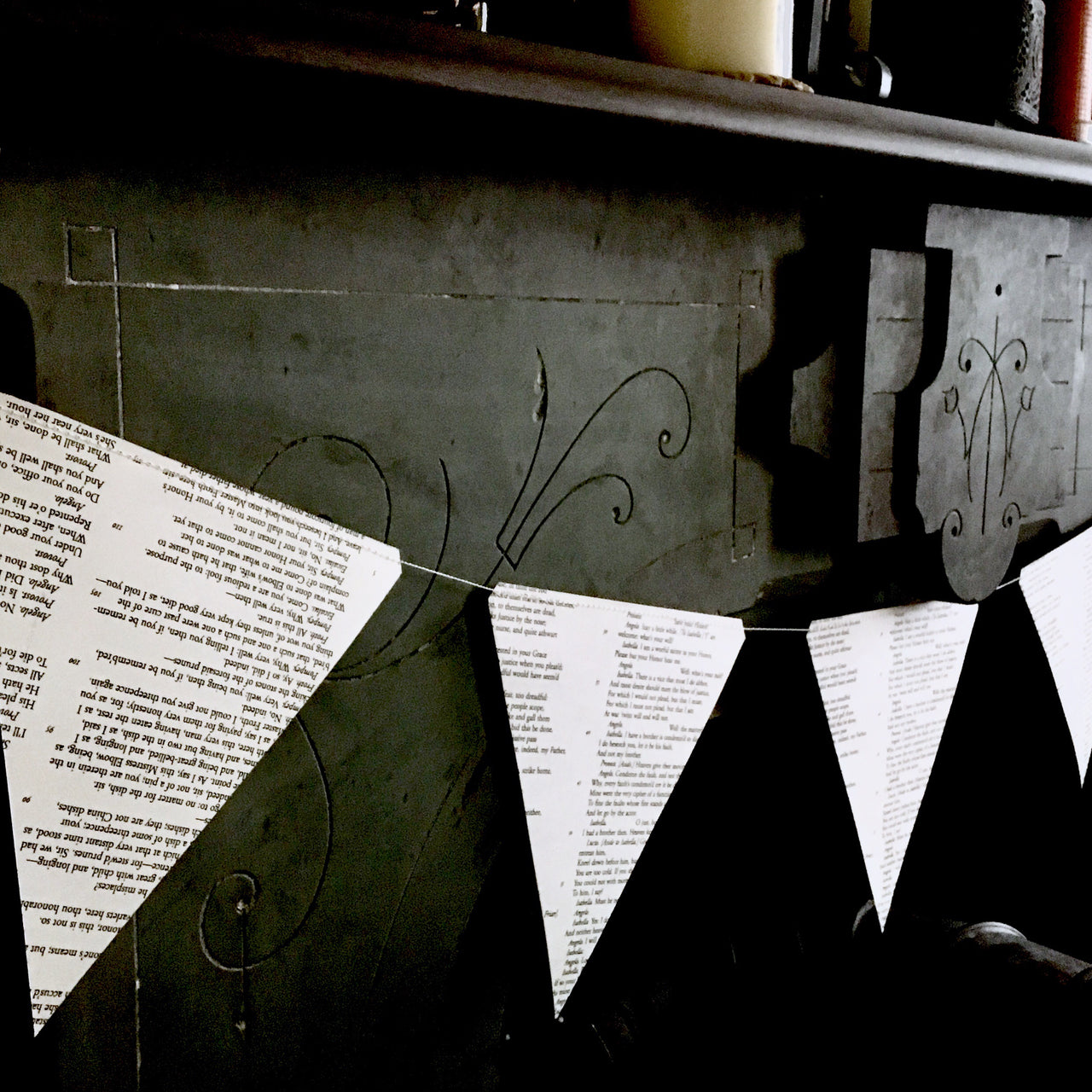 Shakespeare Paper Garland shown on slate mantle