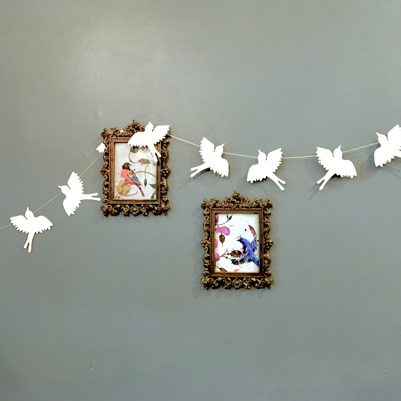 Swallow Silhouette Garland shown on wall