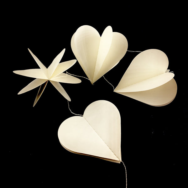 Open Heart Paper Garland shown folded and unfolded