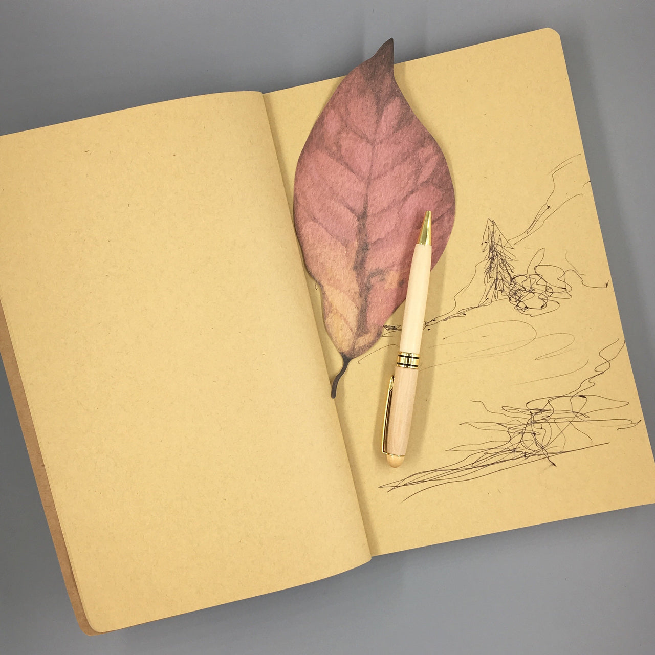 Twine-Bound Kraft Sketchbook shown open to a sketch