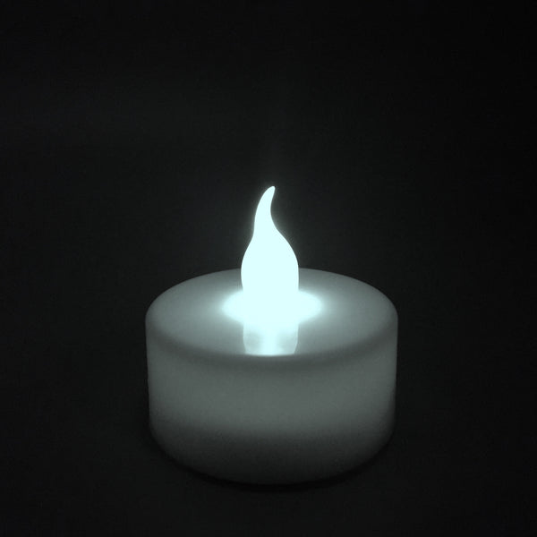 LED Flicker Candle shown illuminated in dark