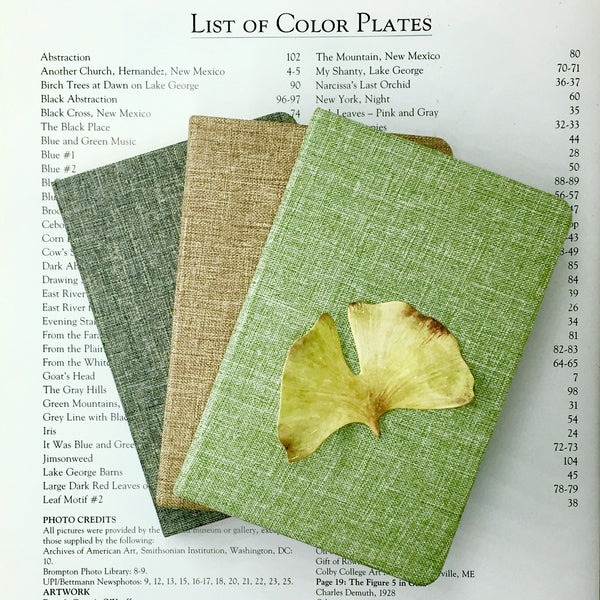 Cloth Pocket Notebook shown in Three Colors