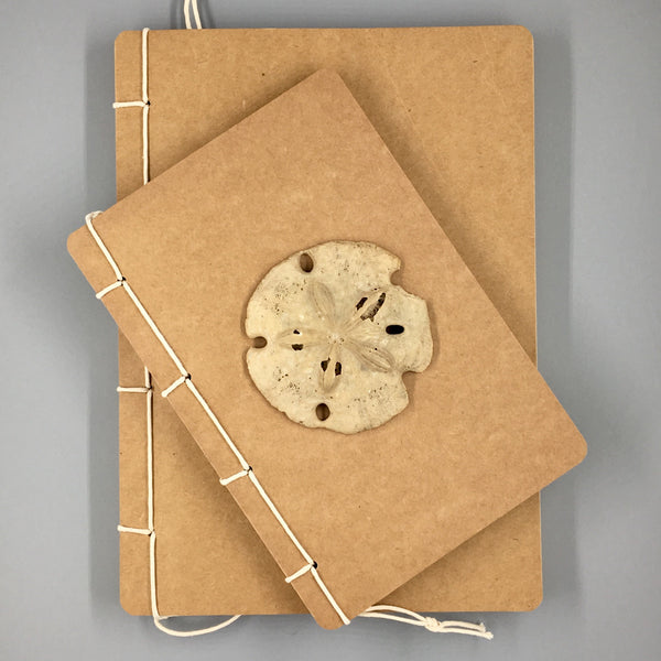 Twine-Bound Kraft Sketchbook shown large and small  with sand dollar
