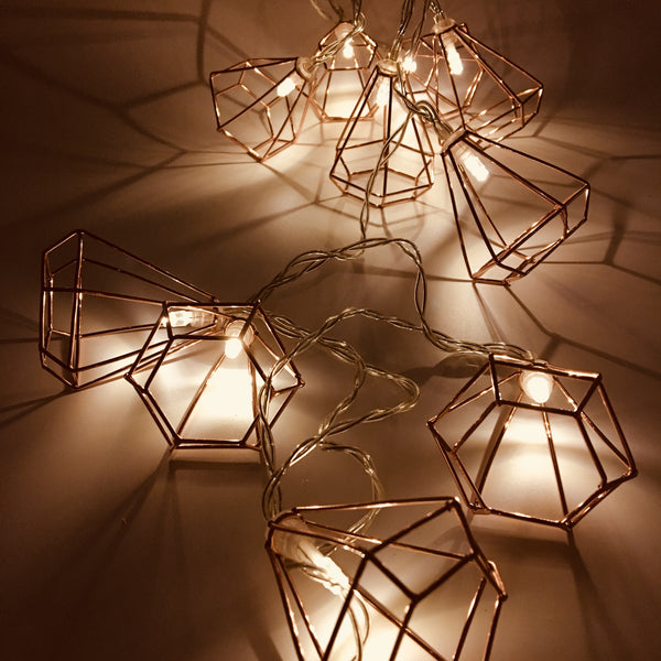 Copper Wire LED Lantern Garland shown illuminated in the dark