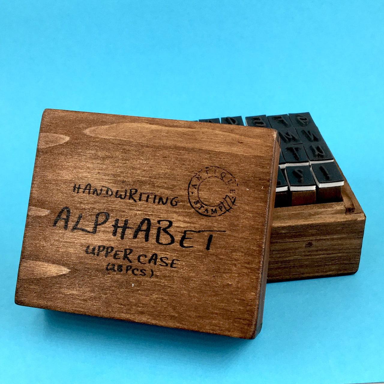 Boxed Wooden Letter Stamp Set shown in uppercase