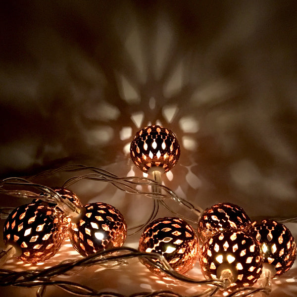 LED Copper Lantern Garland shown illuminated in the dark