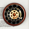 Rotary Phone Paperweight shown on book