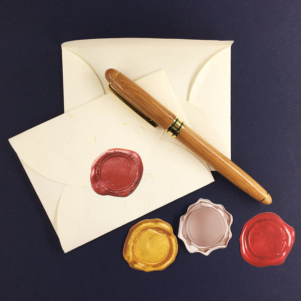 Sealing Wax Stickers Shown in Gold, Silver and Red
