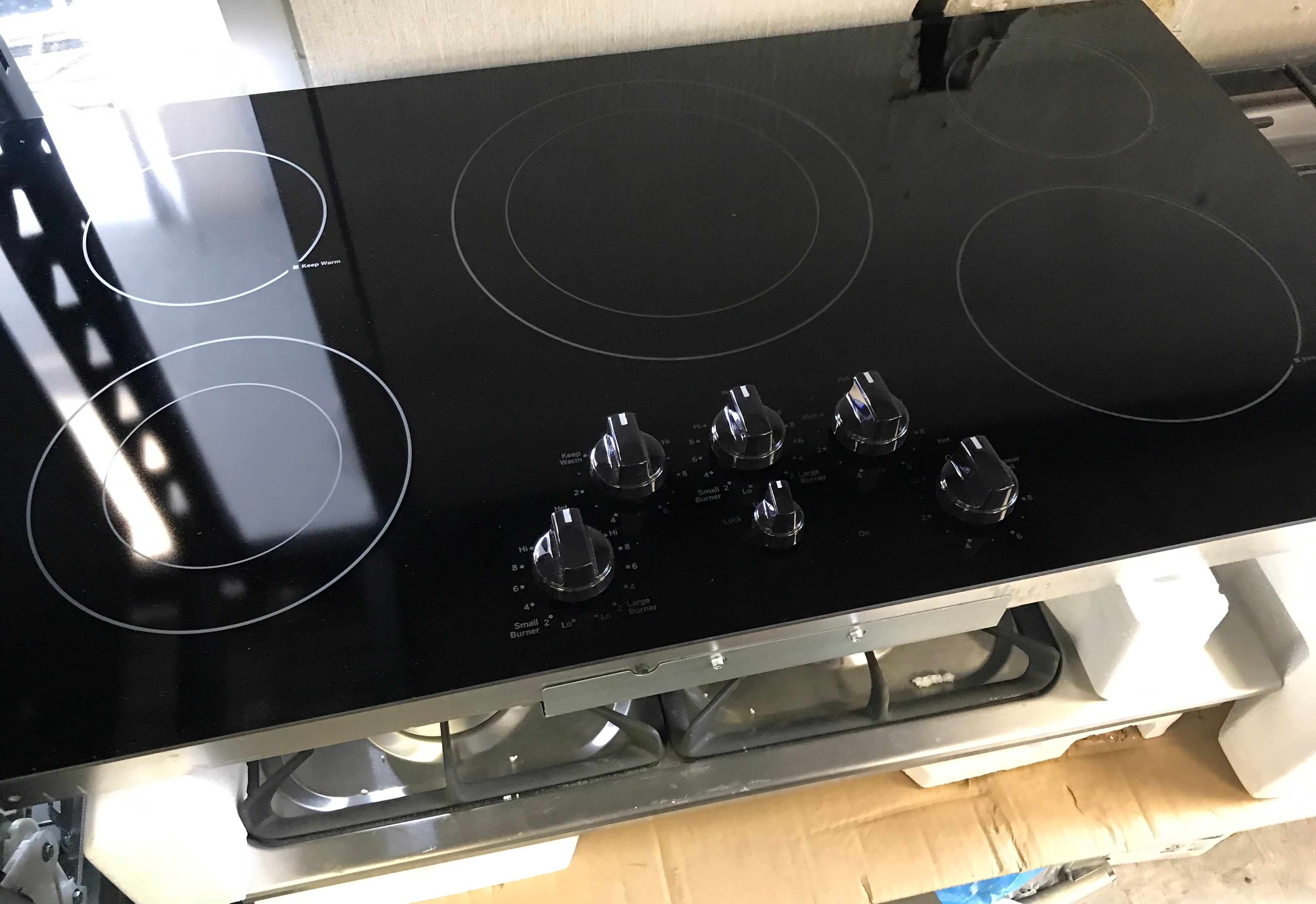 "Brand New GE - 30"" Electric Cooktop - Black stainless steel Model:PP7030BMTS"