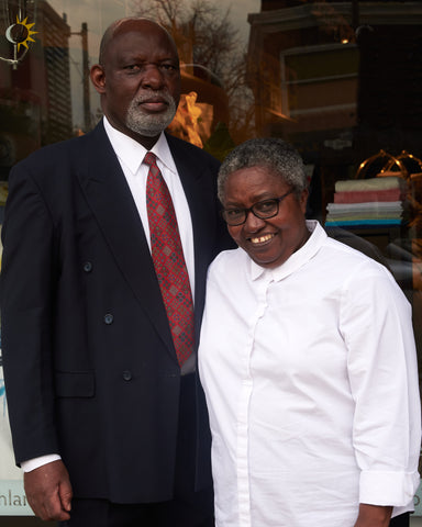 Patterson & Georgina Mudereri in front of the store