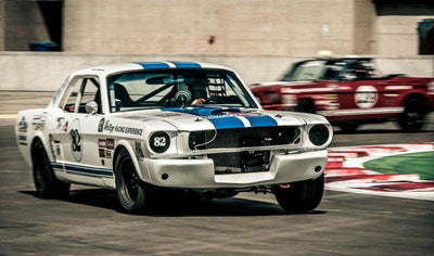 Get behind the wheel of a vintage mustang by Course Vintage