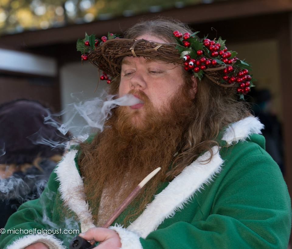 Smoking a Dwarf pipe, dressed as The Ghost of Christmas Present, at the Texas Renaissance Festival.