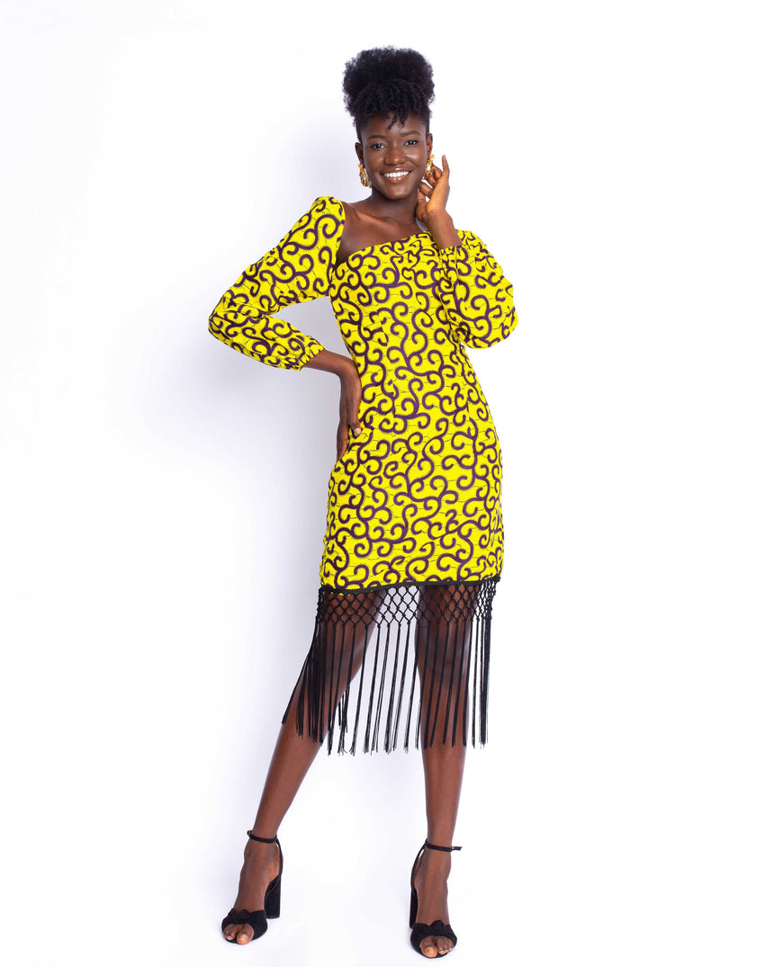 Model Behavior Midi Dress: A fitted midi dress with a cut out neckline and long elastic puff sleeves sealed off with our fun tassels by JVK Clothing