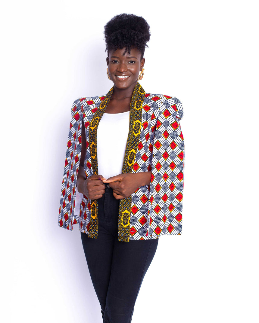 Too Cool For School Jacket: A loosely fitted ankara jacket with cut out sleeves and bold shoulders by JVK Clothing