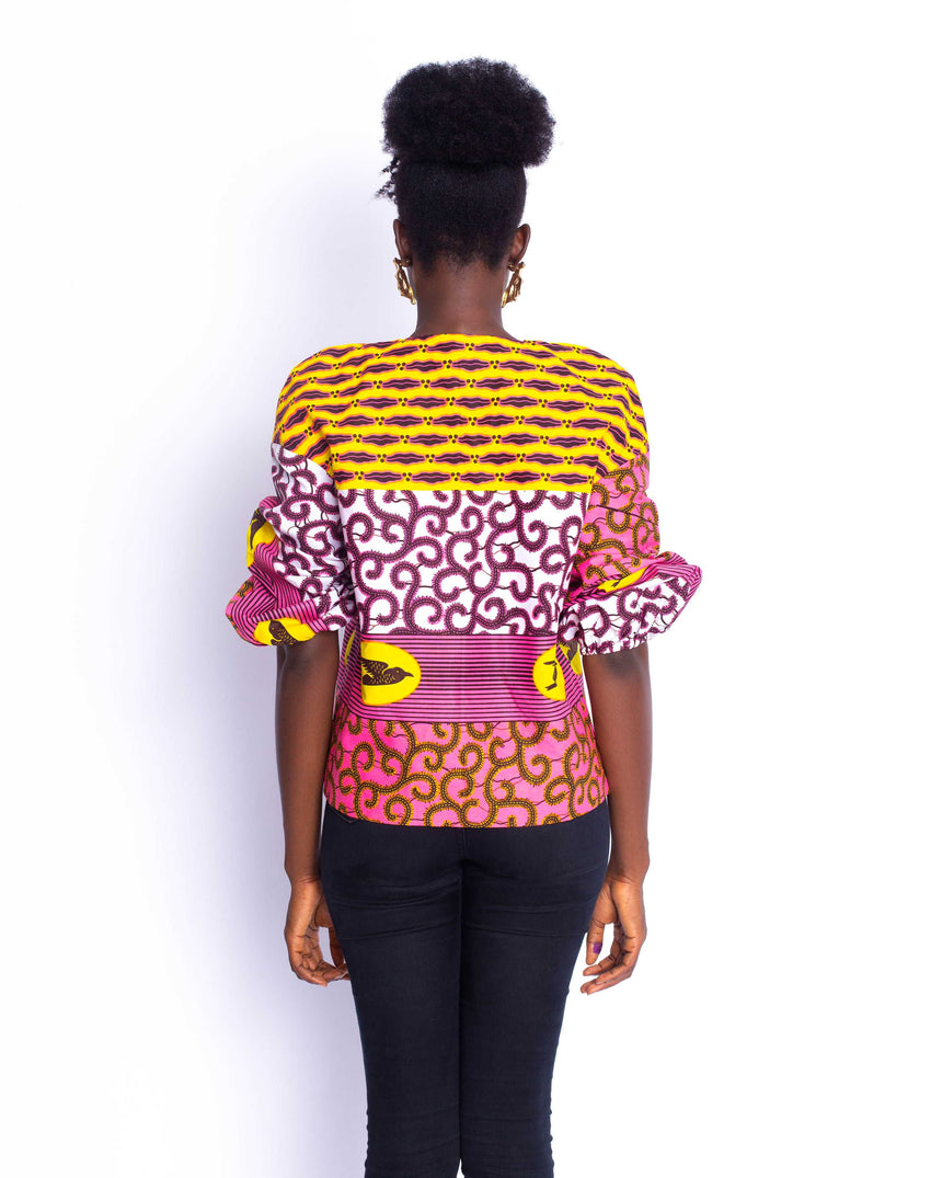 Free Spirit Jacket: A brightly colored puff sleeve jacket with assorted patterns fused together by JVK Clothing
