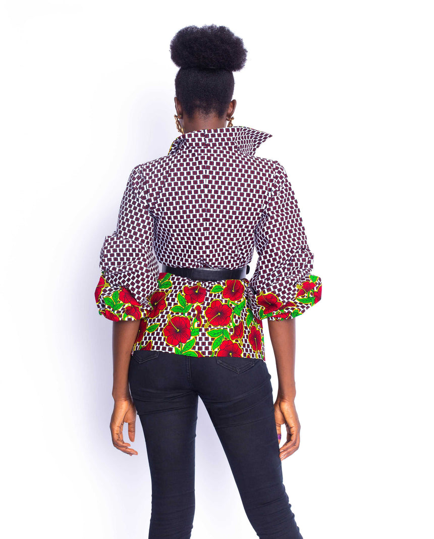 Attitude Gyal Jacket: A hight rise neck jacket with elasticated puff sleeves and alluring floral patterns by JVK Clothing