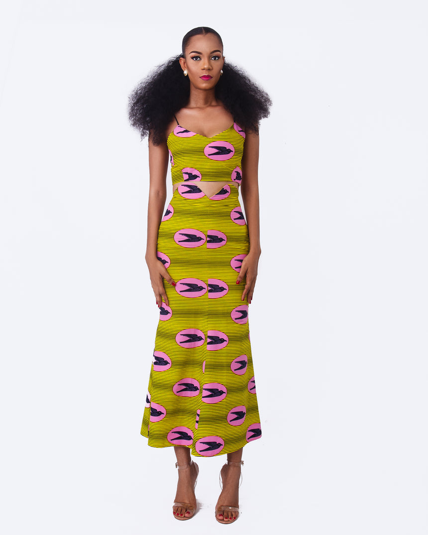 Fireworks Two Piece Combo, A two piece set featuring a crop top and a fitted midi length skirt with a cut out waist line made with African print fabric by JVK