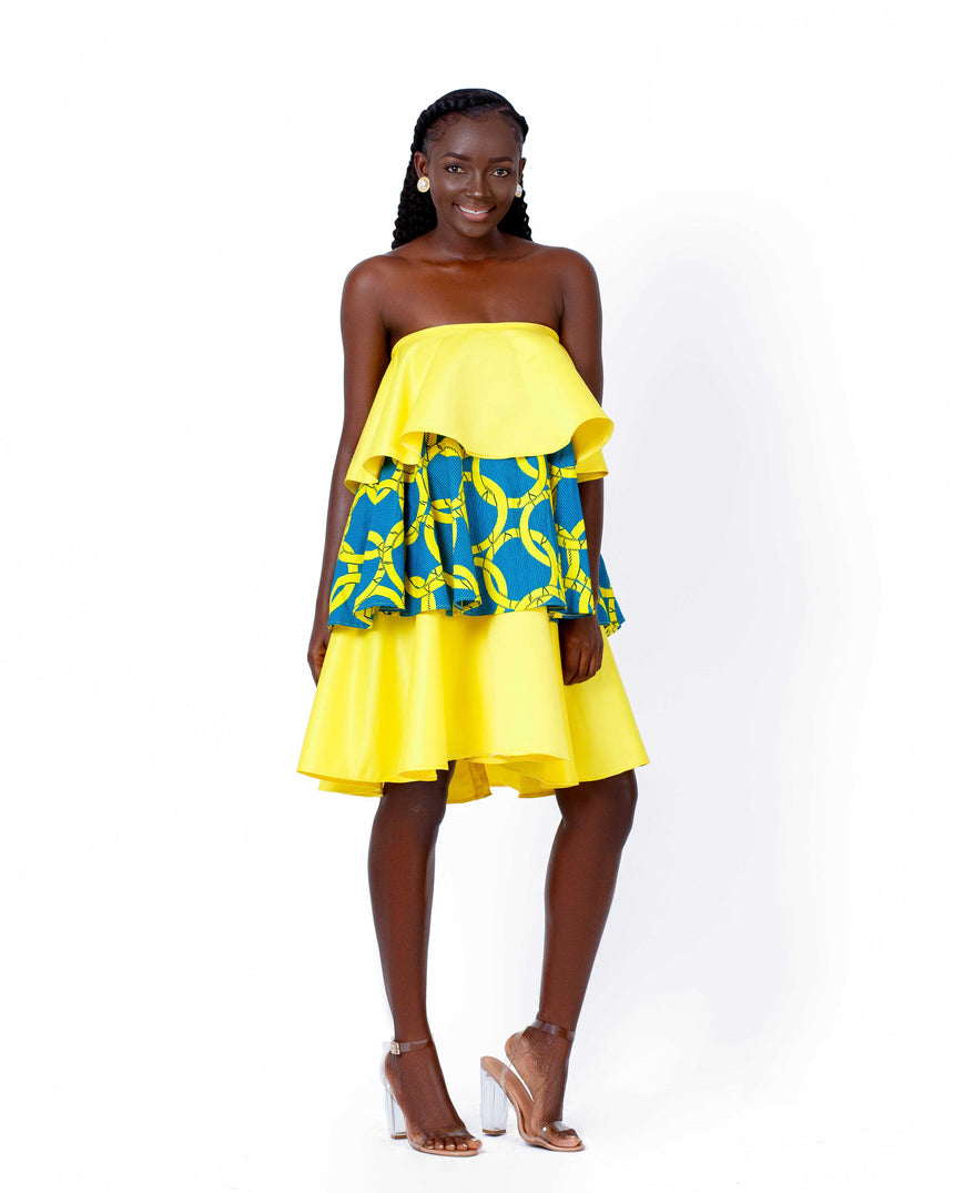 Mellow Yellow - A three tiered off shoulder mini dress featuring Duchess satin and contrasting African print fabric by JVK Clothing