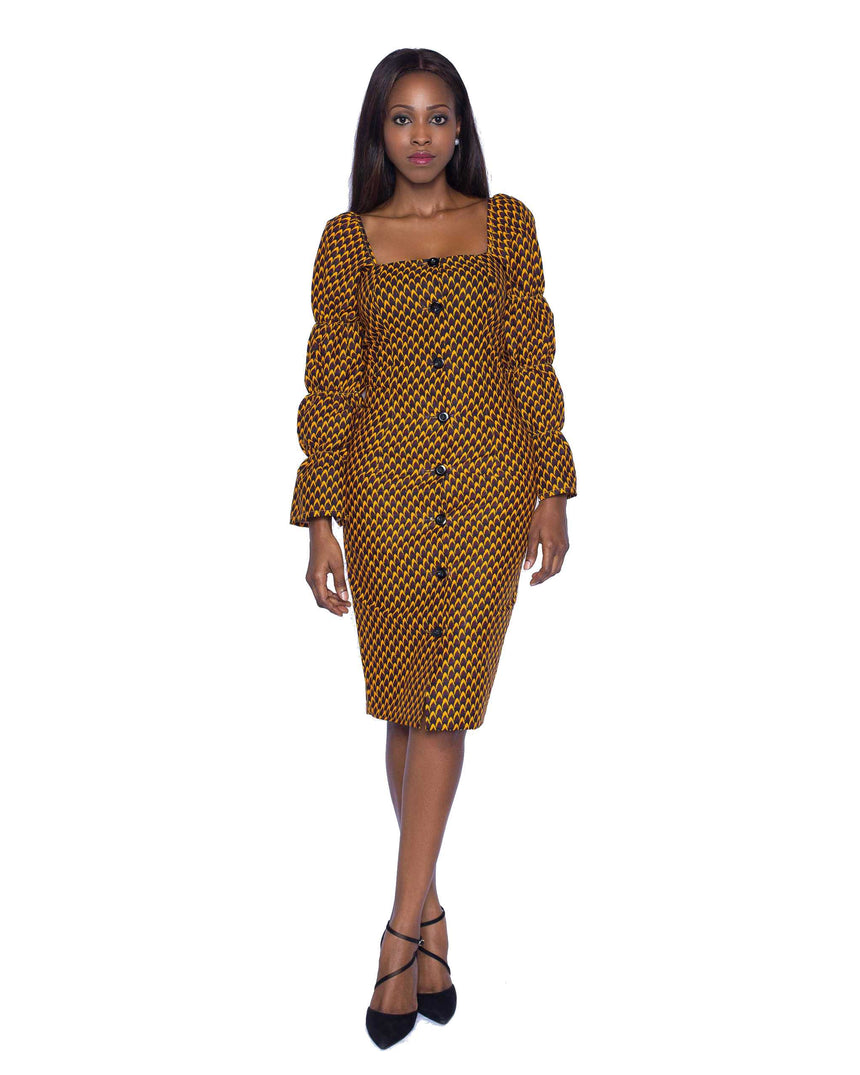 Axim Delight Midi Dress by JVK Clothing is a fitted square neck button down midi dress made with African print fabric featuring elasticated long sleeves. Ideal for both formal and semi formal events with the right pair of shoes.