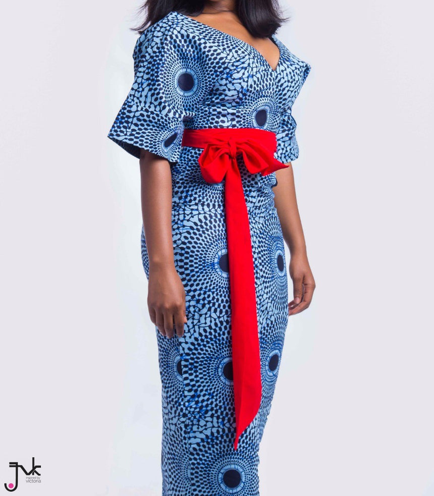 WCE Midi Dress, A fitted midi dress with oversize summer sleeves and bold red belt made with African print fabric by JVK