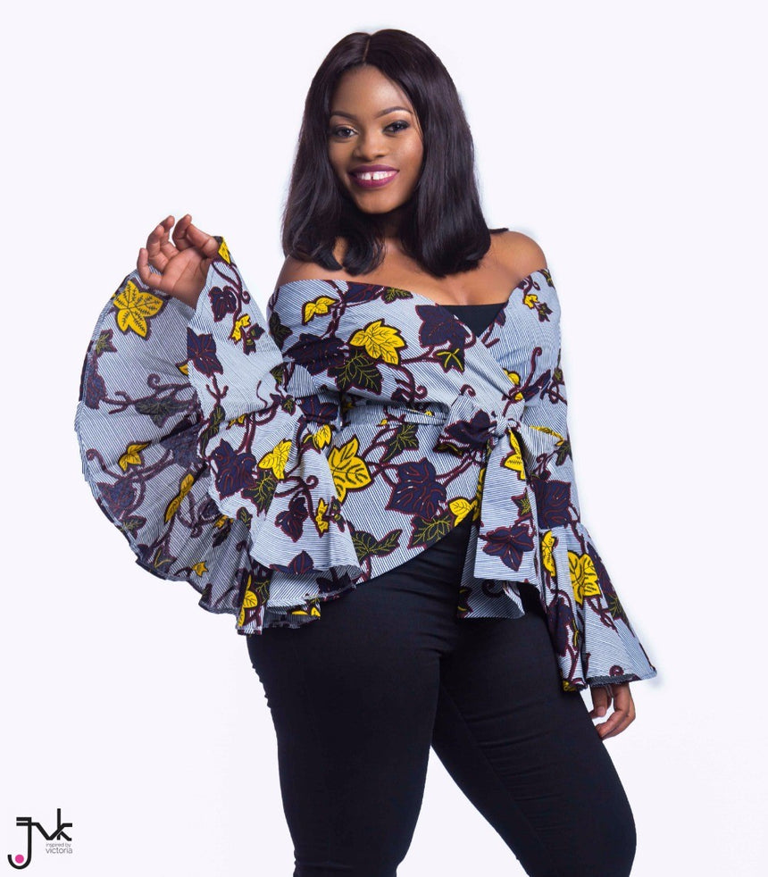 Internet Sensation Off Shoulder Top, A belted off-shoulder blouse with exaggerated sleeves made with African print fabric by JVK